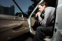 Man sitting in the car Stock Images
