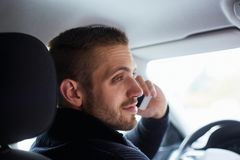 Man sitting in car and calls stock image