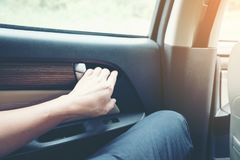 Man sitting in car and hold hand Open car doors. Thailand Royalty Free Stock Photo