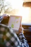 Man sitting in car and holding tabletnavigation Royalty Free Stock Photo