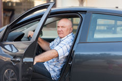 Man sitting in   car. Stock Image