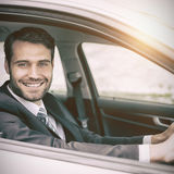 Man sitting in a car smiling and looking at camera Royalty Free Stock Photos
