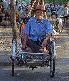 Man is sitting in a cart on street in Hue, Vietnam Stock Image