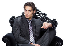Man sitting in chair Stock Images
