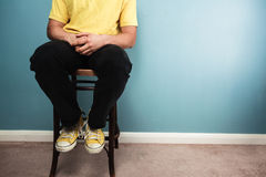 Man sitting on a chair Royalty Free Stock Images
