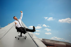 Man sitting on chair and flying stock photo