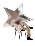 Man sitting on a chair and holding a five-pointed star Stock Images