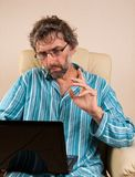 Man sitting in chair with laptop. Mature man sitting in chair with laptop Royalty Free Stock Photos