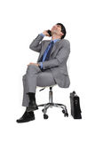 Man sitting in a chair Stock Photography
