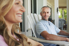 Man Sitting On Chair At Porch Royalty Free Stock Photos