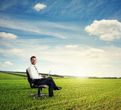 Man sitting on the chair and smiling Stock Photo