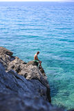 Man sitting on a cliff Royalty Free Stock Photo