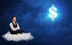 Man sitting on a cloud dreaming of money. Caucasian businessman sitting on a white fluffy cloud wondering about huge money sign stock photography