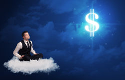 Man sitting on a cloud dreaming of money. Caucasian businessman sitting on a white fluffy cloud wondering about huge money sign stock images