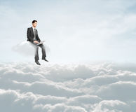 Man sitting on cloud Stock Images