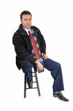 Man sitting in coat. Stock Images
