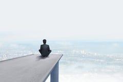 Man sitting on concrete bridge Stock Photo