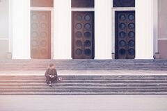 Man Sitting on a Concrete Stair Waiting for Someone during Daytime Royalty Free Stock Images