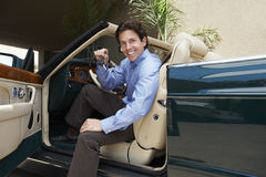 Man Sitting In Convertible Holding Car Key Royalty Free Stock Photo