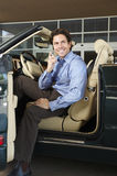 Man Sitting In Convertible Using Cell Phone Royalty Free Stock Photo