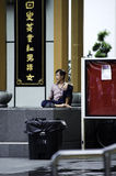 Man Sitting in a Corner, Chinatown singapore Royalty Free Stock Images