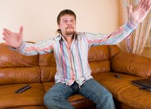 Man sitting on the couch Royalty Free Stock Images