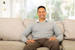 Man sitting couch Royalty Free Stock Photography