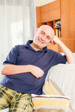 Man sitting on couch royalty free stock photo
