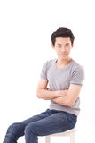 Man sitting with crossing arms, white isolated Stock Photo