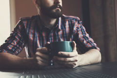 Man sitting with cup of morning coffee or tea Royalty Free Stock Image