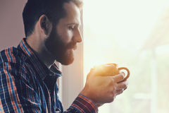 Man sitting with cup of morning coffee or tea Stock Photos