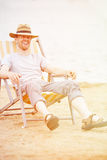 Man sitting in deck chair in summer Royalty Free Stock Image