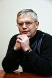 Man sitting at desk Royalty Free Stock Photos