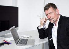Man sitting at desk Royalty Free Stock Photography