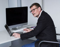 Man sitting at desk Royalty Free Stock Image