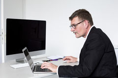 Man sitting at desk Stock Image