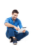 Man sitting with digital tablet Royalty Free Stock Photography