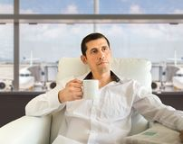 Relaxing at the airport with coffee royalty free stock photos