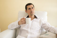 Man sitting drinking tea and thinking Royalty Free Stock Photo