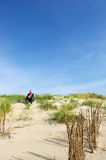 Man is sitting in the dunes Stock Photo