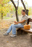 Man sitting eating apples Stock Photos
