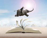Man sitting on elephant running and jumping on flipping pages to vector illustration