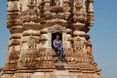 Man sitting at entrance of 12th-century tower Royalty Free Stock Images