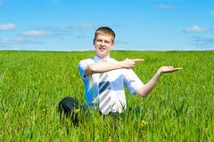 Man sitting in field Stock Images