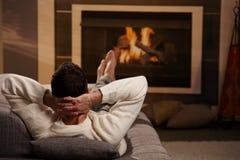 Man sitting at fireplace Royalty Free Stock Photos