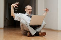 Man sitting on the floor Stock Photos
