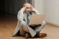 Man sitting on the floor Royalty Free Stock Images