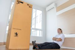 Man is thinking about the large package stock images