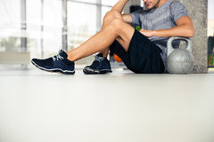 Man sitting on the floor at gym Stock Photos