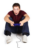 Man sitting on floor, holding joystick Royalty Free Stock Photography